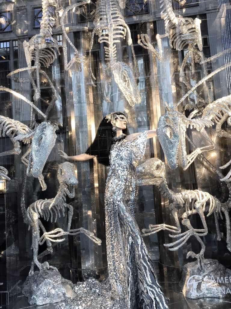 Bergdorf Goodman's 2017 holiday windows feature a To New York, With Love Theme showcasing several NYC institutions including the American Museum of Natural History with a window of crystal covered dinosaur skeletons.