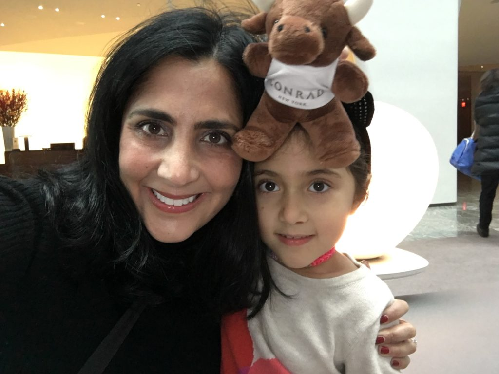 Young travelers receive a stuffed Conrad bull at Conrad, New York.